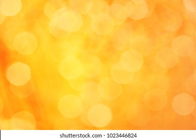 yellow and orange color abstract bacground withe blurred defocus bokeh light for template