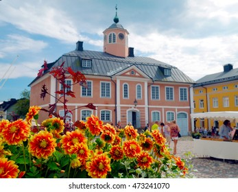 Yellow and orange flowers in front of town hall in Porvoo, Finland