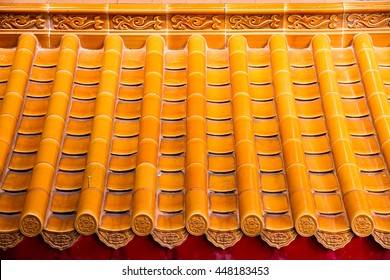 Yellow orange glazed terracotta  roof tiles of a Chinese temple.