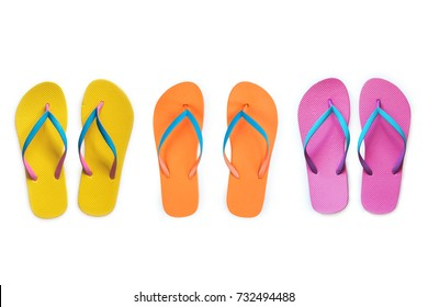Yellow Orange Pink flip flops isolated on white background. Top view