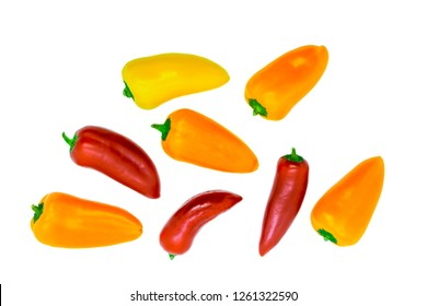 Yellow, orange and red sweet mini paprika isolated on white background