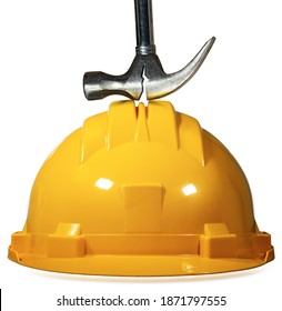 Yellow and orange safety helmet with a broken hammer on it, isolated on white background. Concept of safety at work.