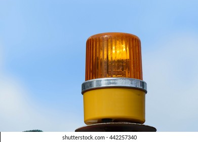Yellow orange siren lights are not activated with blue sky and cloud