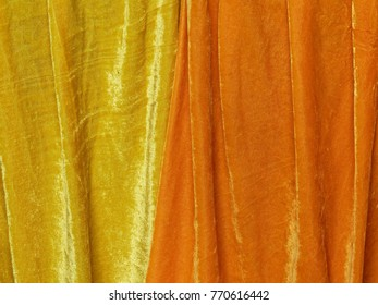 yellow and orange velvet blanket in a budhist temple in shanghai china