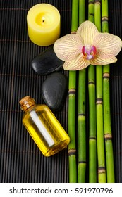 Yellow orchid ,stones,oil,bamboo grove,candle on mat background