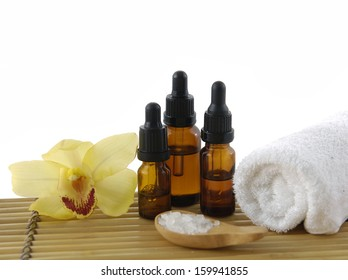 Yellow orchid and Zen rock ,massage oil ,towel on bamboo mat