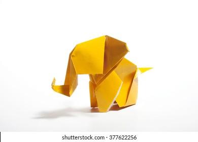 Yellow origami elephant  isolated on white background