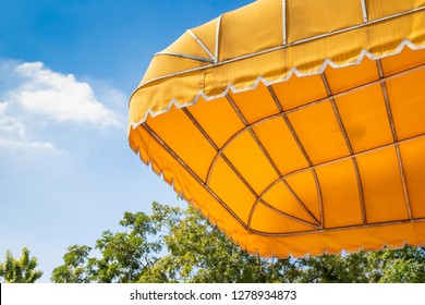 yellow outdoor awning with blue sky background. exterior shading canvas.
