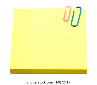 yellow pages of notebook with paper clip on white