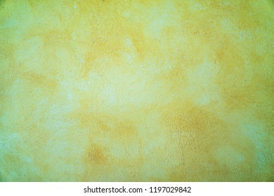 Yellow paint cement wall , vintage wall Textured background .