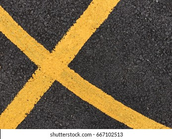 Yellow paint line on black asphalt road surface texture. space transportation background