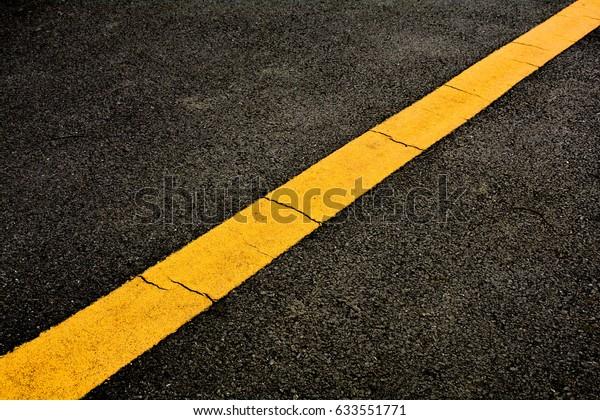 Yellow Paint Line On Black Asphalt Stock Photo (Edit Now