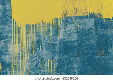 Yellow paint on blue. Grunge background