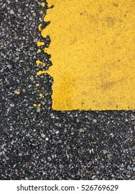 yellow paint on the road (tar)