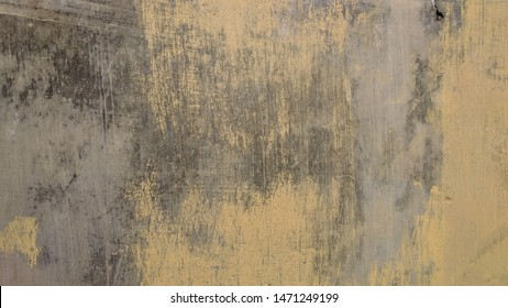 Yellow paint scratch old concrete wall texture, use as background or wallpaper