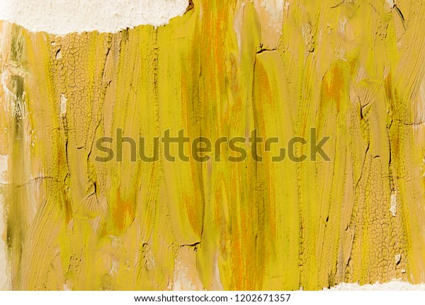Yellow painted background with torn paper edges