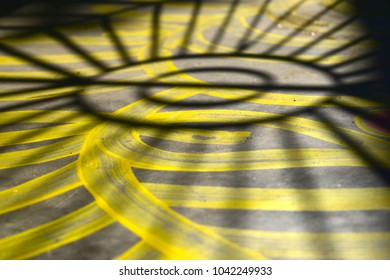 Yellow painted colours with black shadows unique abstract background photo