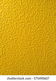 Yellow painted textured bumpy background with space for text. Can be used as a background for Easter and other occasions.