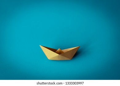 yellow paper boat on bright background with copy space, learning and education concept