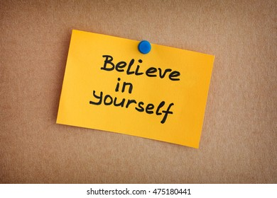 Yellow paper note with phrase Believe In Yourself. Close up.
