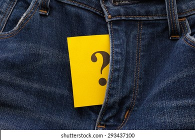 Yellow paper note with question mark appears out in jeans fly. Sexual issues concept.