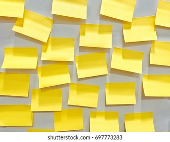 yellow paper note stick on the wall at the office