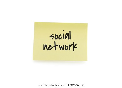 Yellow paper note with the words social network, isolated on white background