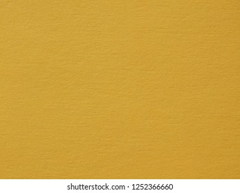 Yellow paper texture useful as a background, soft pastel colour