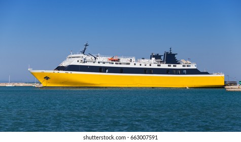 Yellow passenger ship moored in port of Zakynthos, Greek island in the Ionian Sea, popular tourist destination for summer holidays