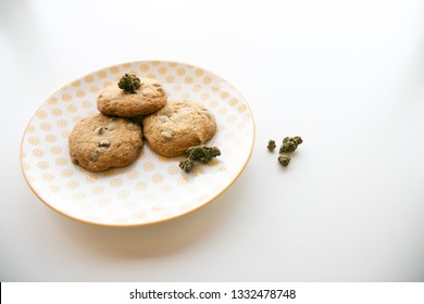 Yellow Patterned Plate with Chocolate Chip Cookies and Marijuana Buds