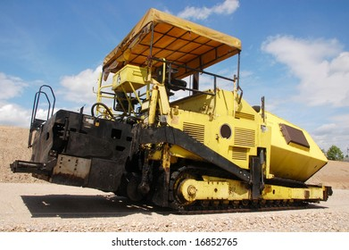 Yellow paver machine for road construction