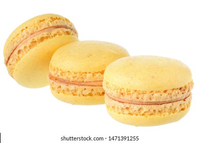 Yellow peach macaroon close up isolated on white background.