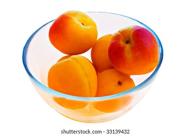 yellow peaches in a glass bowl