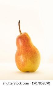 Yellow pear isolated on white background.