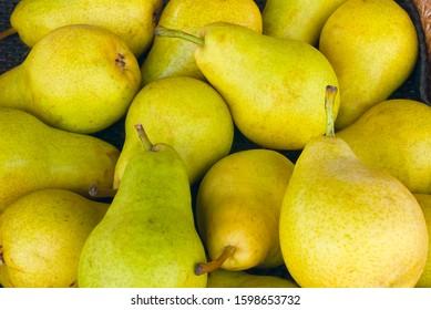 yellow pears at the market fresh organic fruits