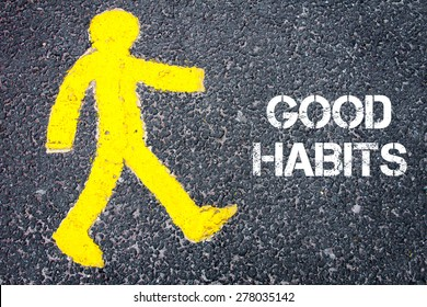 Yellow pedestrian figure on the road walking towards GOOD HABITS. Conceptual image with Text message over asphalt background.