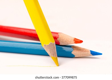 yellow pencil with line over white background