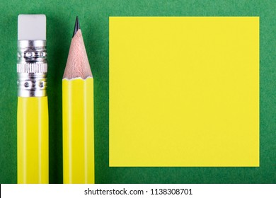 Yellow pencils over green background with yellow space for text.
