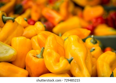 Yellow pepper in a crate on a market