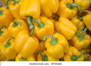 Yellow pepper vegetables on a market stall.