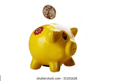Yellow Piggy Bank against white background