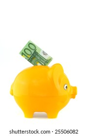 Yellow piggy bank with Euro money in front of a white background