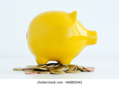 Yellow piggy bank isolated on white background suggesting family savings concept