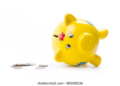 yellow piggy bank isolated on white