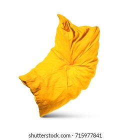 Yellow pillow on isolated white background. The pillow runs away from sleep. The concept of the demon.