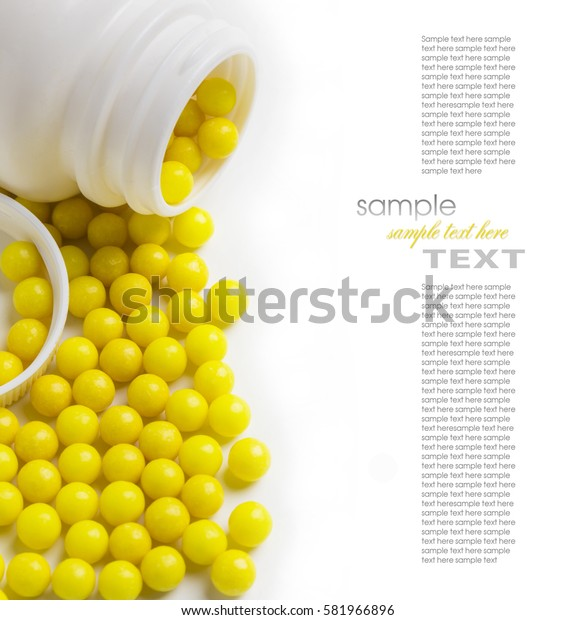 yellow pills in the pack closeup Isolated on white background