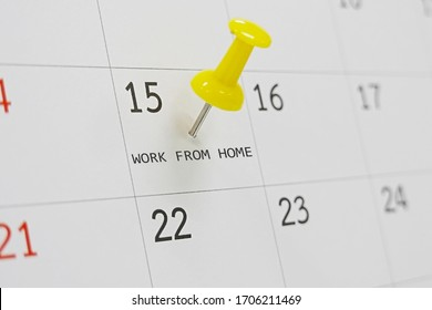yellow pin on calendar with work from home text, in concept of social distancing, work from home