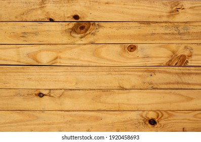 Yellow pinus wood table background, lots of contrast, wooden texture
