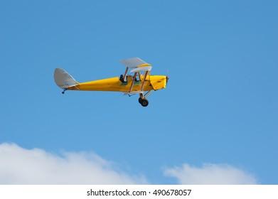 Yellow Plane Blue Sky