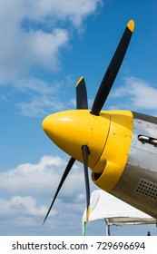 Yellow Plane nose showing propellers very colorful